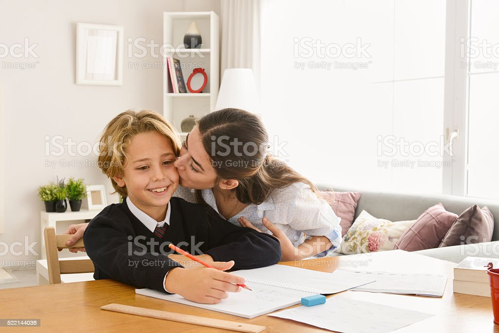 Mother and son studying stock photo