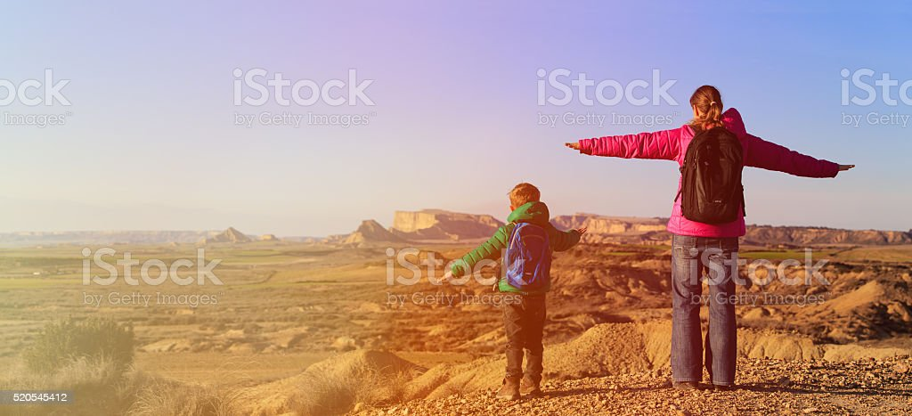 mother and son travel in scenic mountains stock photo