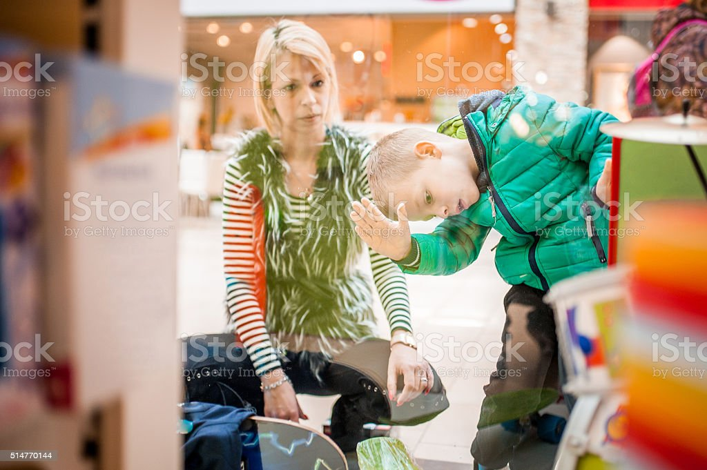 Mother and Son Window Shopping stock photo