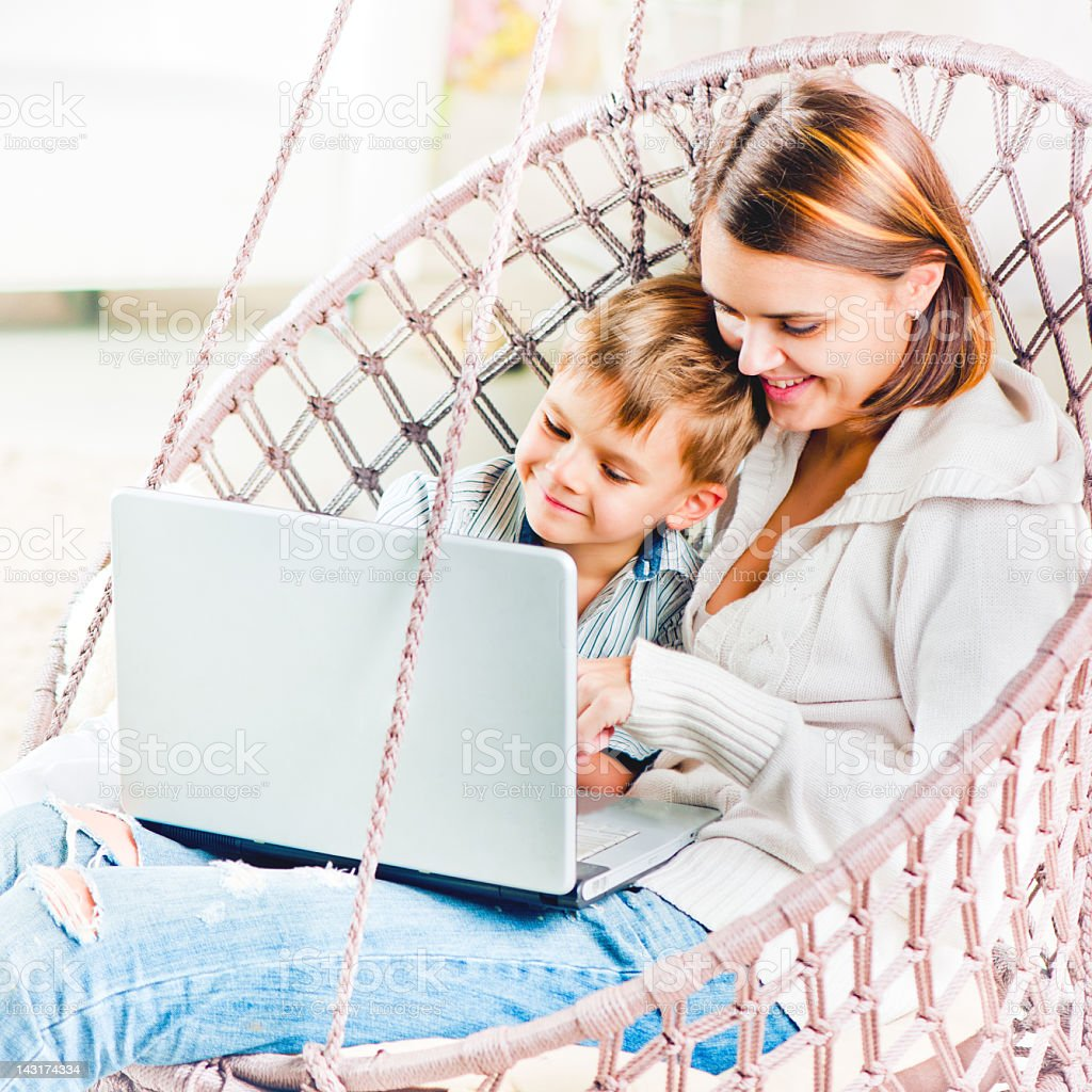 Mother and son with a laptop royalty-free stock photo