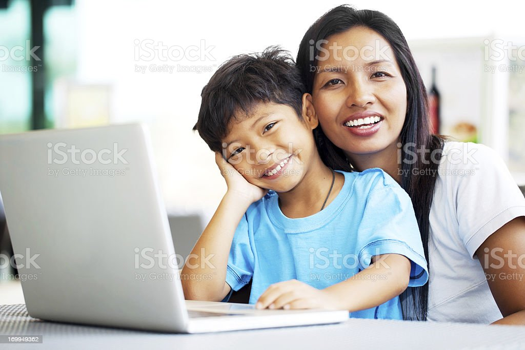 Mother and son with a laptop. royalty-free stock photo
