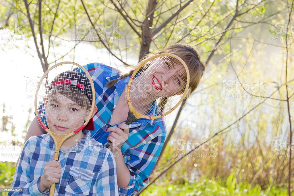Mother and son with badminton racket stock photo