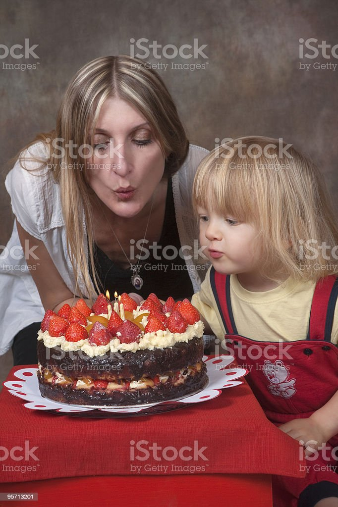 mother and son with birthday cake. stock photo