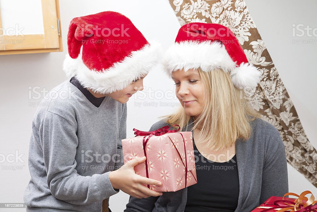 Mother and Son with Christmas presents royalty-free stock photo