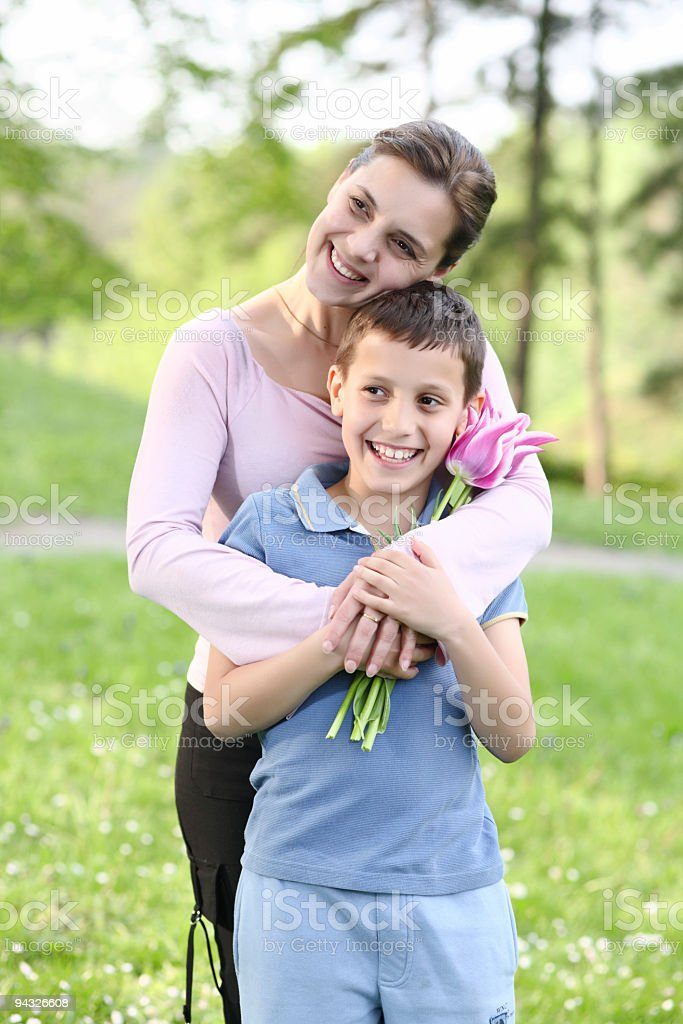 Mother and son with flowers. royalty-free stock photo
