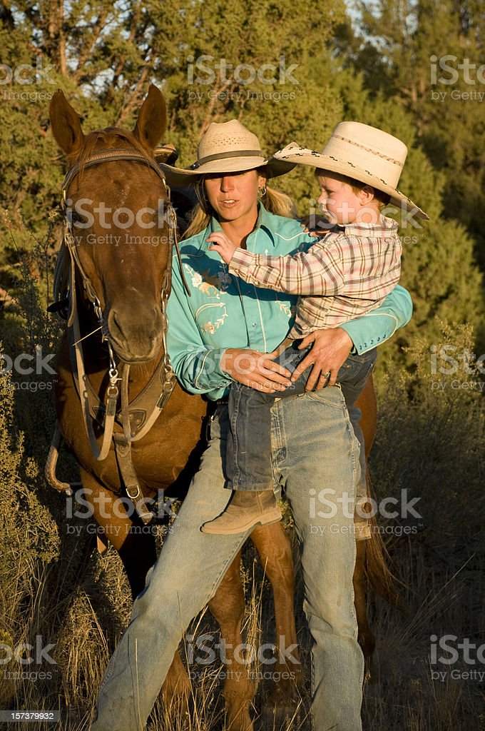 Mother and son with horse royalty-free stock photo