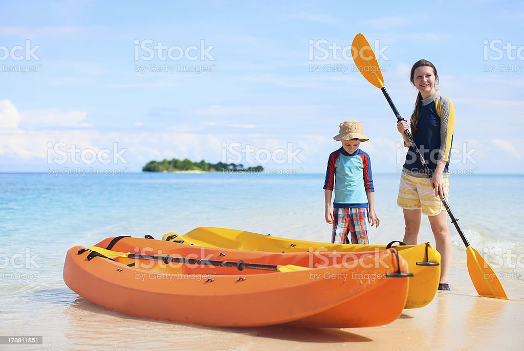 Mother and son with kayaks royalty-free stock photo