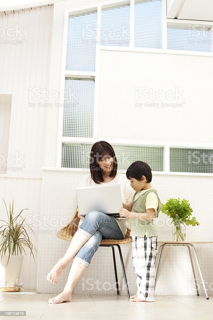 Mother and son with laptop royalty-free stock photo
