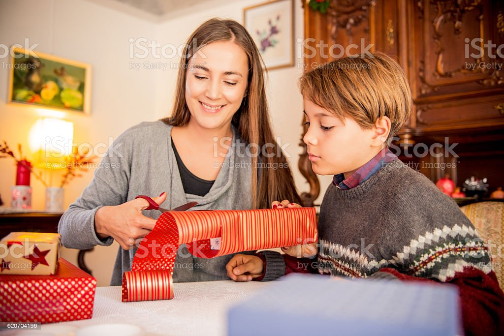 Mother and Son Wrapping Christmas Presents stock photo