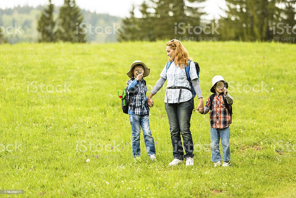 Mother and sons spending the day in nature royalty-free stock photo