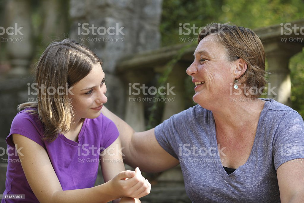 Mother and teenage daughter having a conversation. royalty-free stock photo