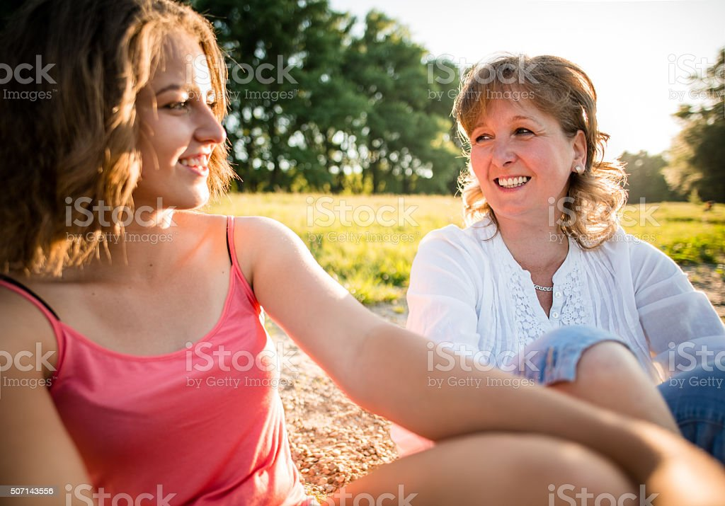 Mother and teenage daughter outdoor portrait stock photo