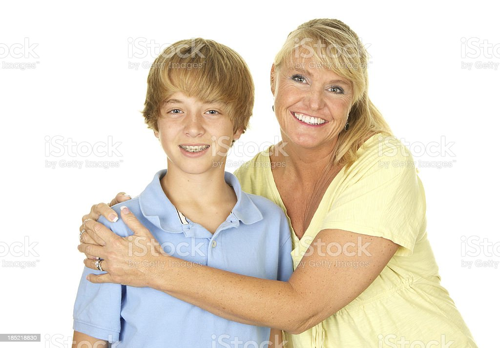 Mother and Teenage Son Smiling on White Background royalty-free stock photo