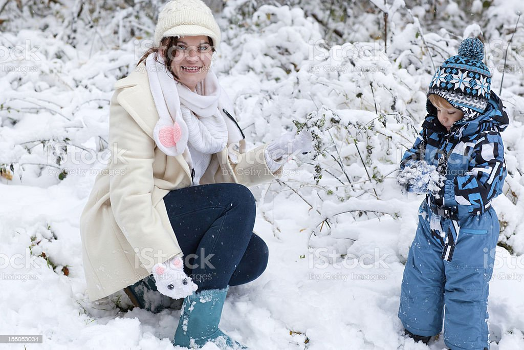 Mother and toddler boy having fun on winter day royalty-free stock photo