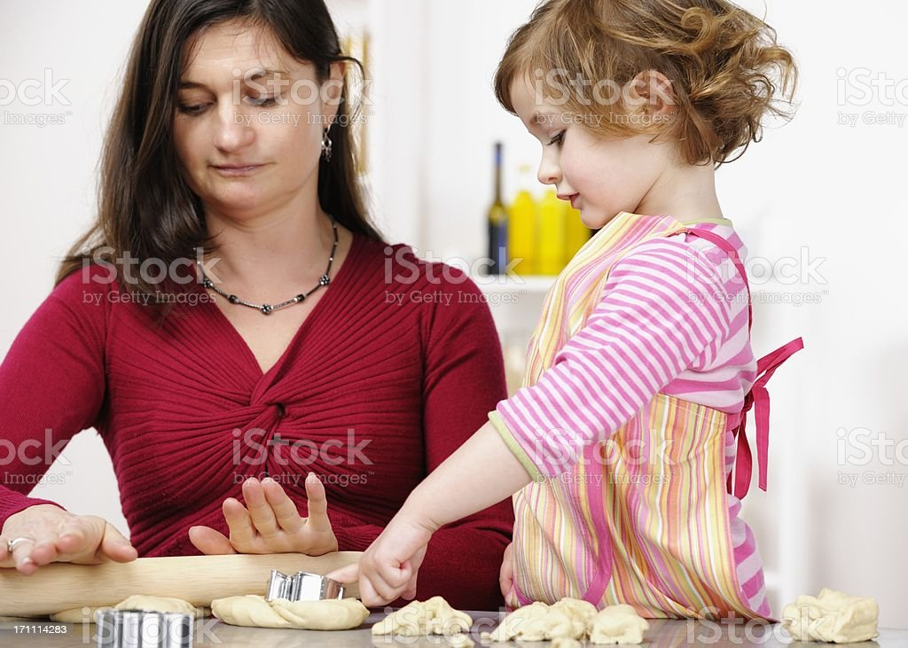 Mother And Toddler/ Little Girl Rolling Dough stock photo