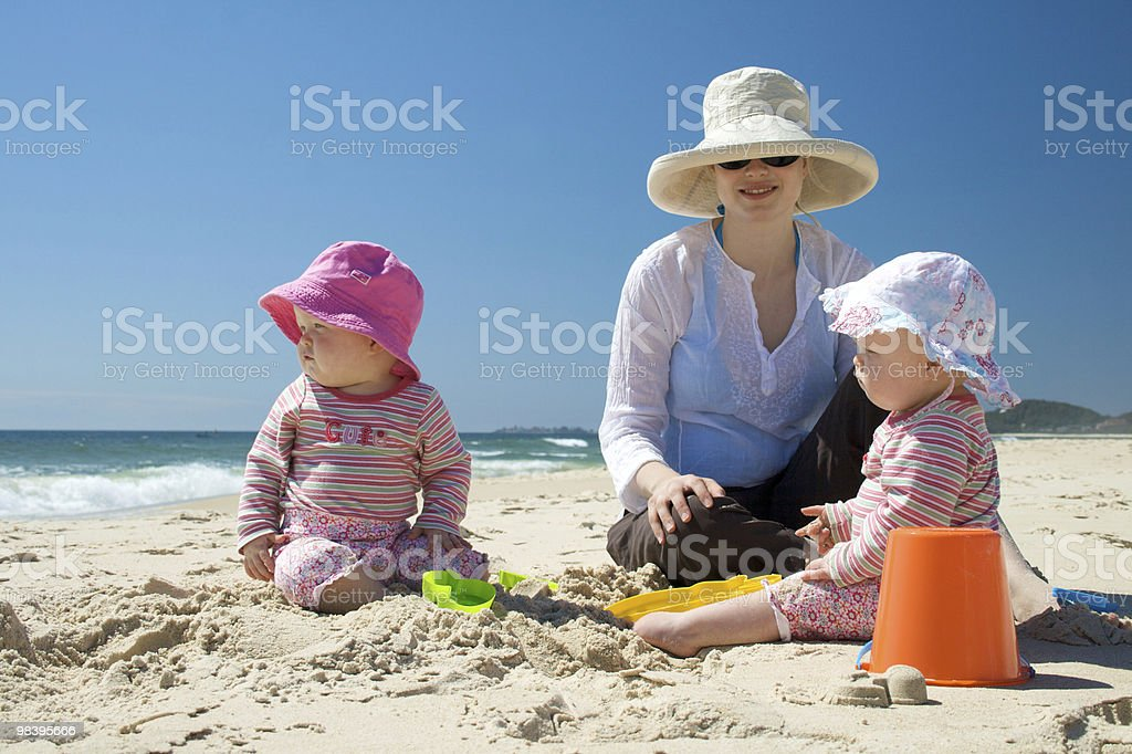 Mother and Twin Babies at the Beach stock photo