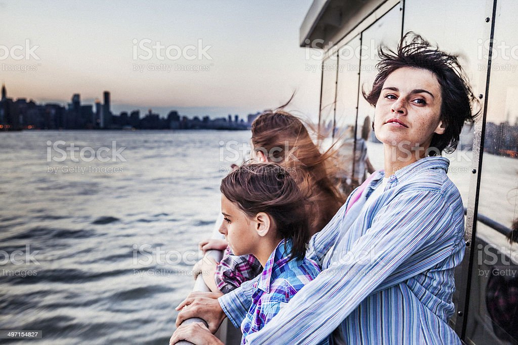 Mother and two daughters at ferry at Hudson River royalty-free stock photo