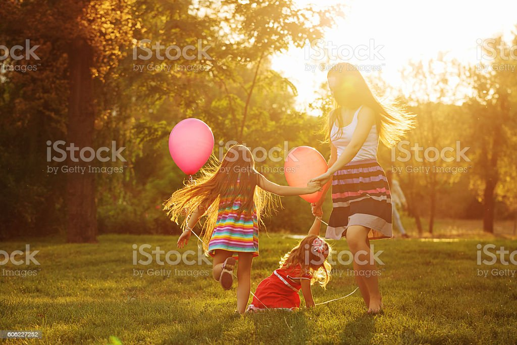Mother and two daughters circling stock photo