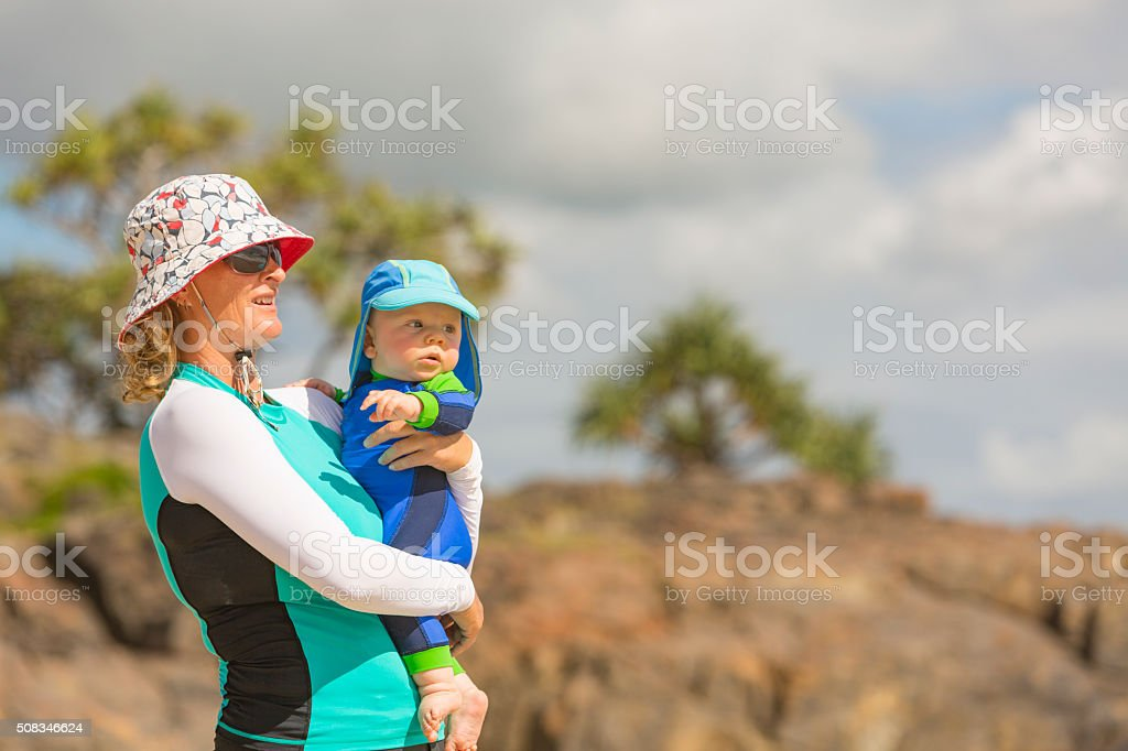 Mother and Young Baby Playing at the Beach stock photo