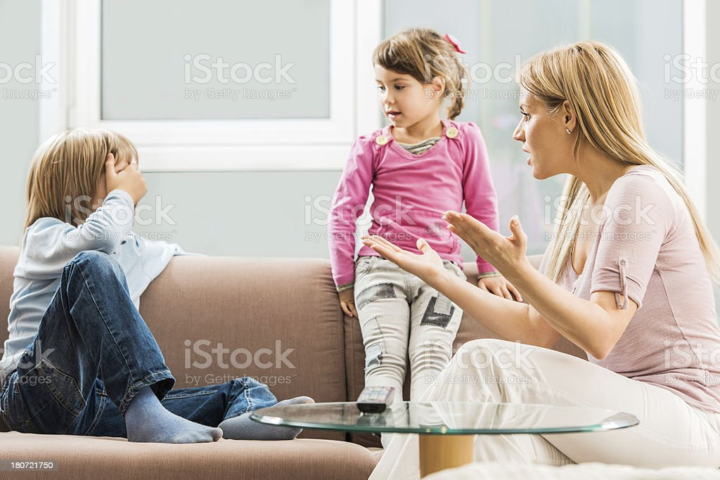 Mother arguing with children. stock photo