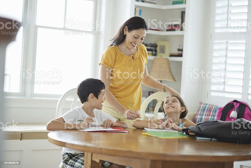 Mother Assisting Children With Studies royalty-free stock photo