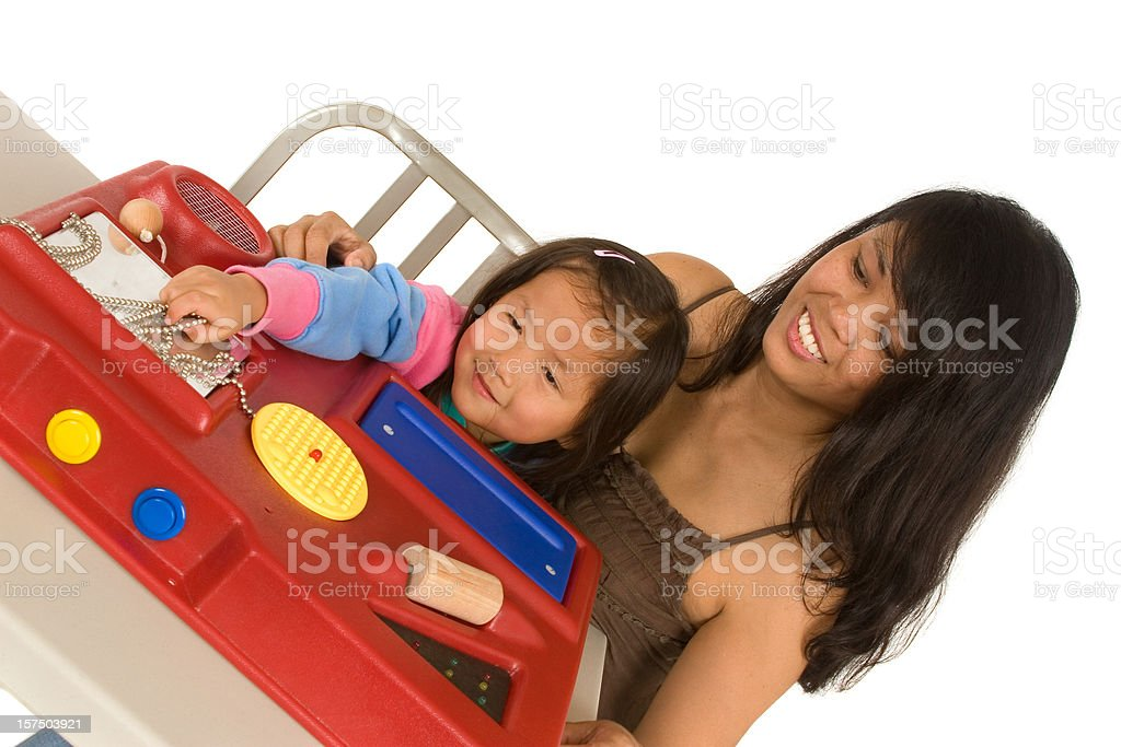Mother assisting daughter with sensory station royalty-free stock photo