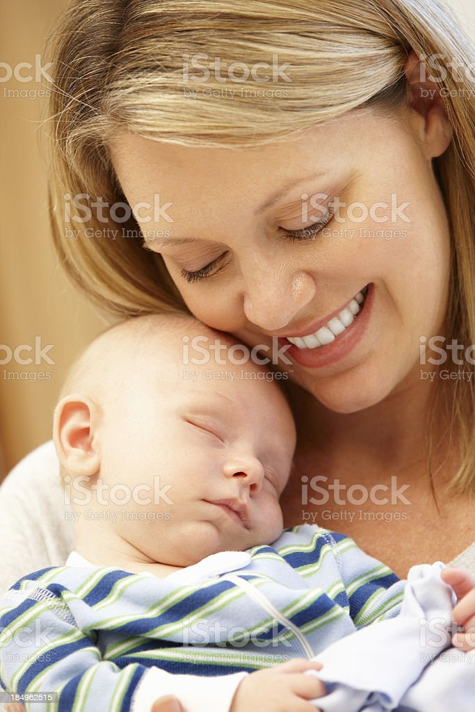 Mother at home with new baby stock photo