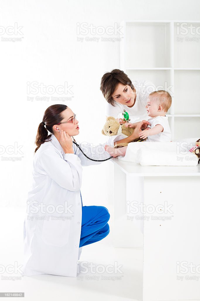 mother baby and pediatrician stock photo
