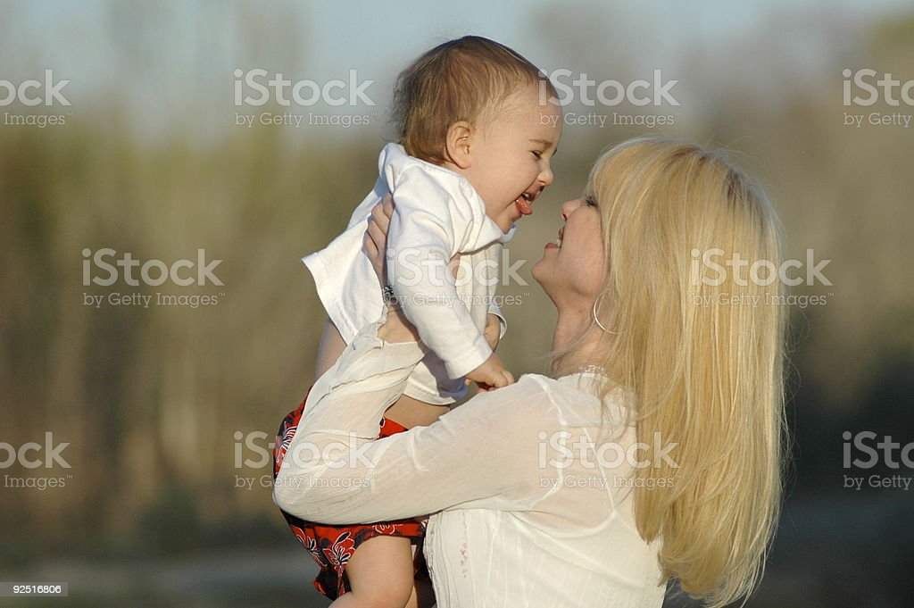 Mother baby holding up high stock photo