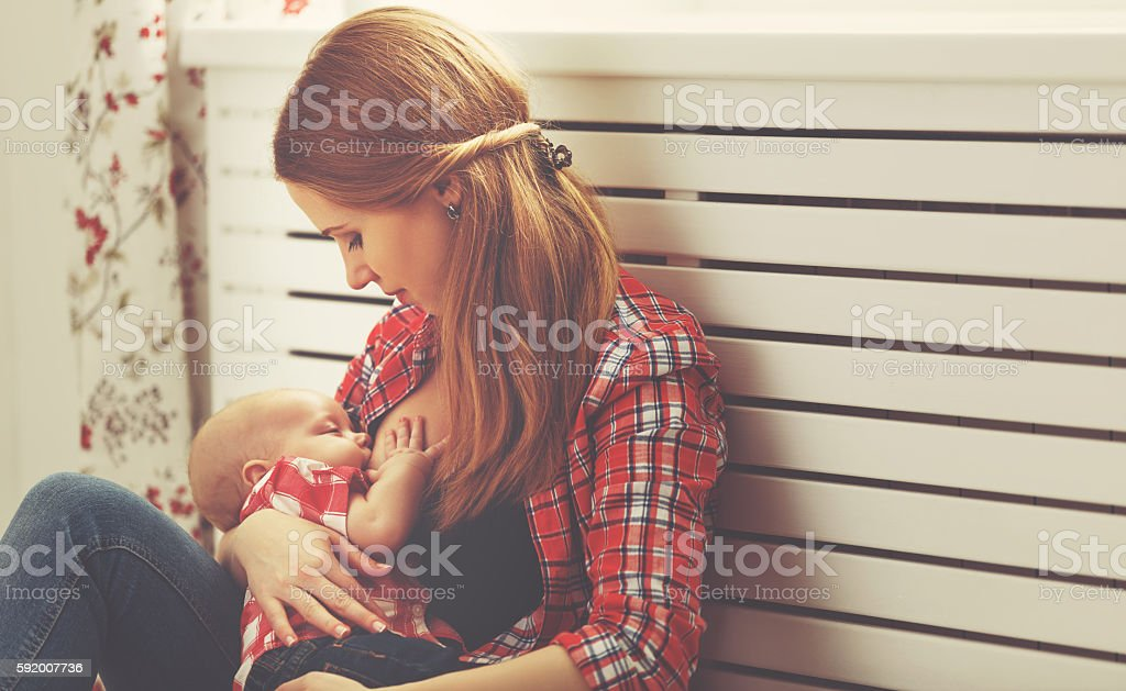 mother breast feeding baby stock photo