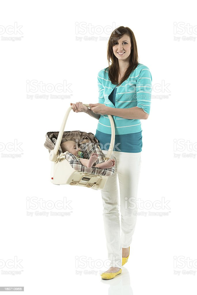 Mother carrying baby in basket stock photo