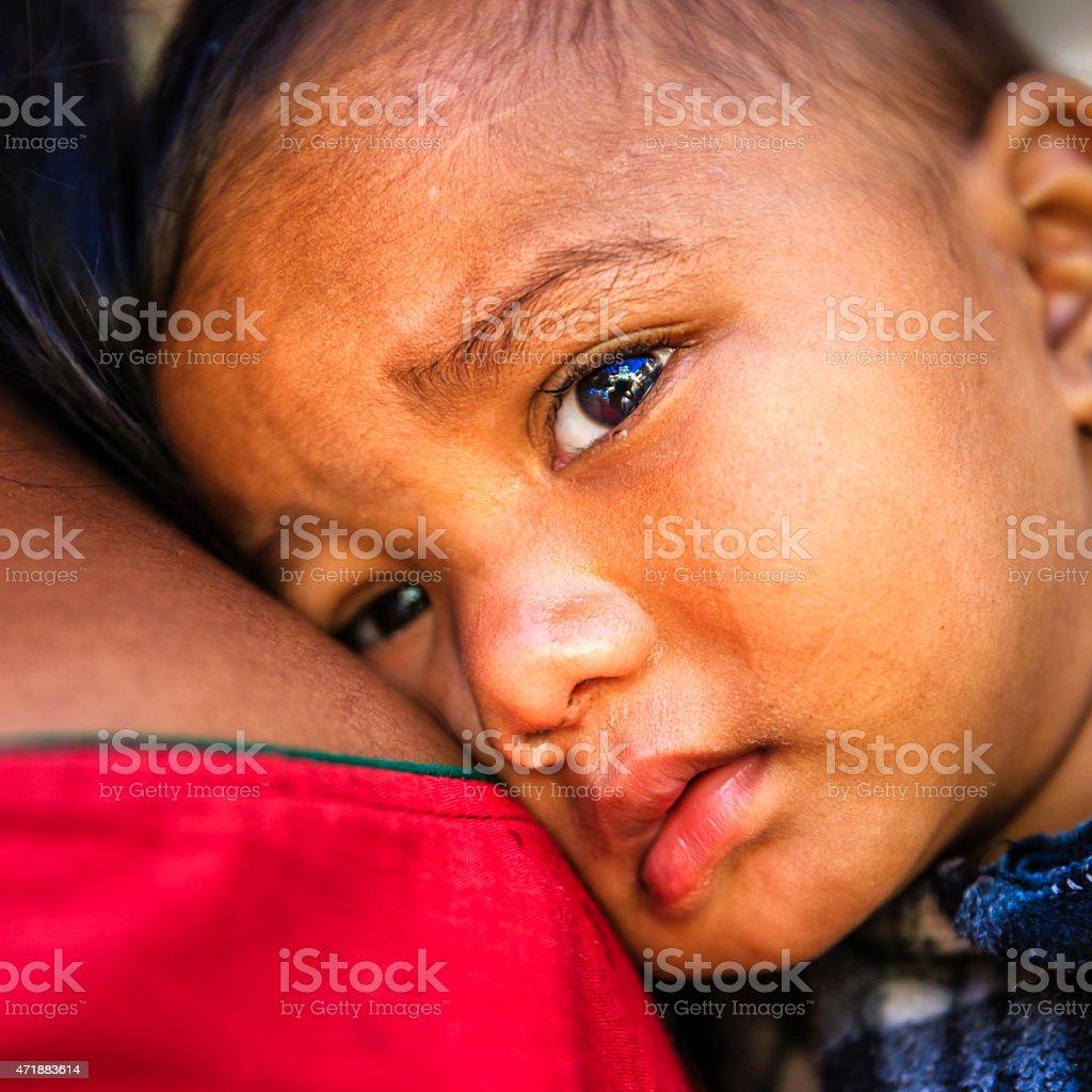Mother carrying crying baby, Kathmandu, Nepal stock photo