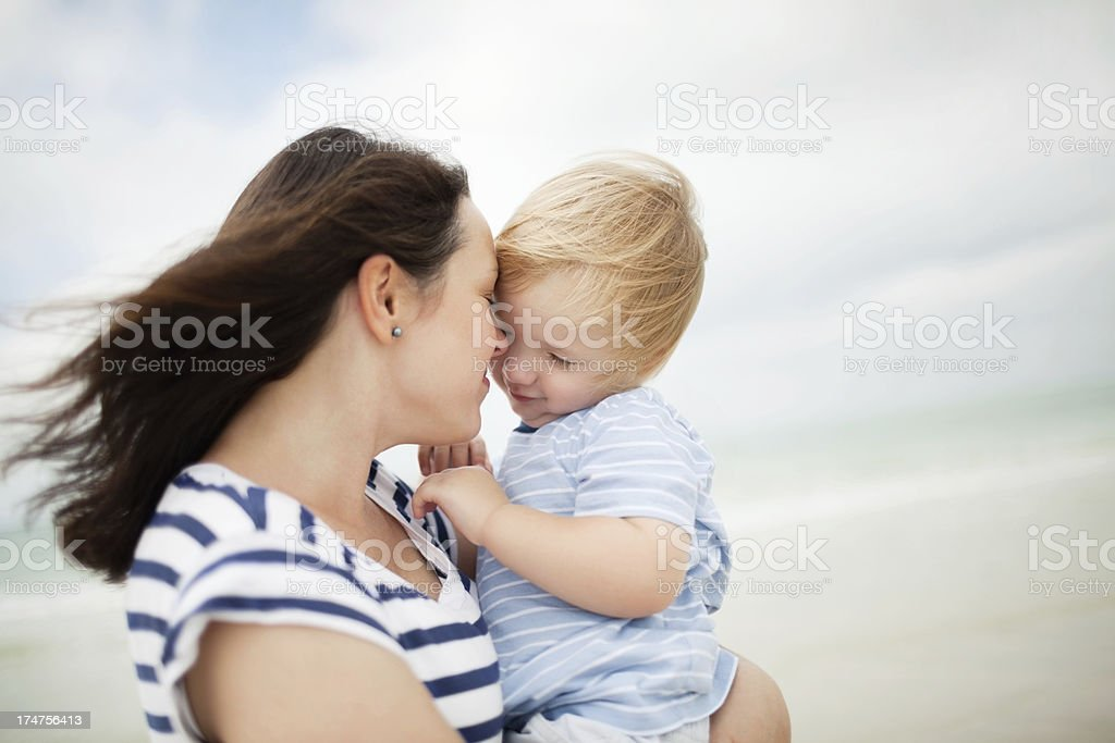 Mother Carrying Cute Little Boy Outdoors royalty-free stock photo