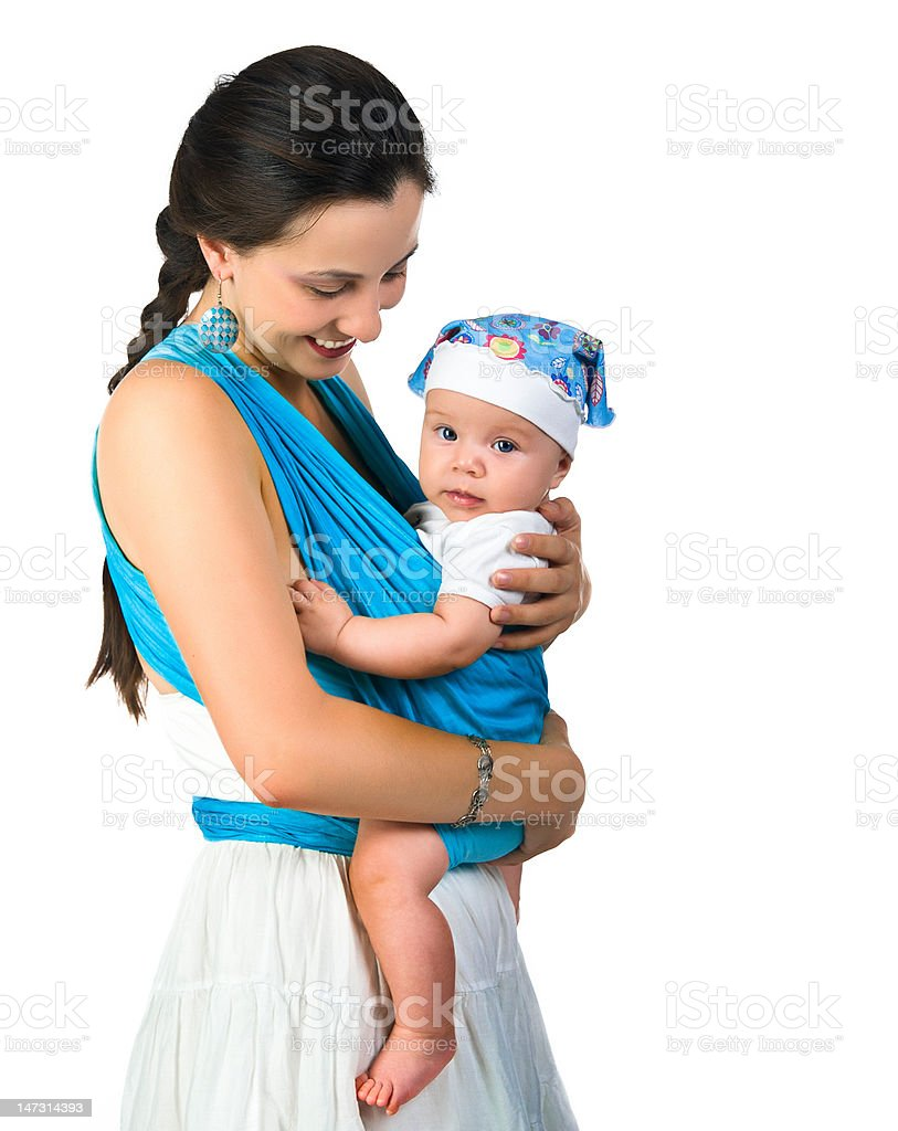 mother carrying her baby in a sling royalty-free stock photo