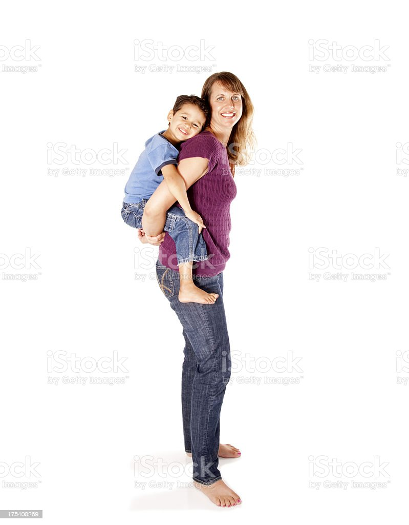 Mother Carrying her Son Piggy Back stock photo