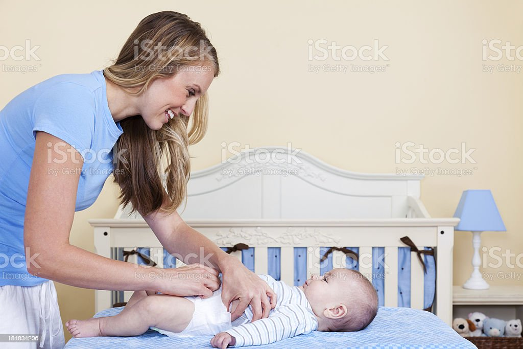 Mother Changing Diaper royalty-free stock photo