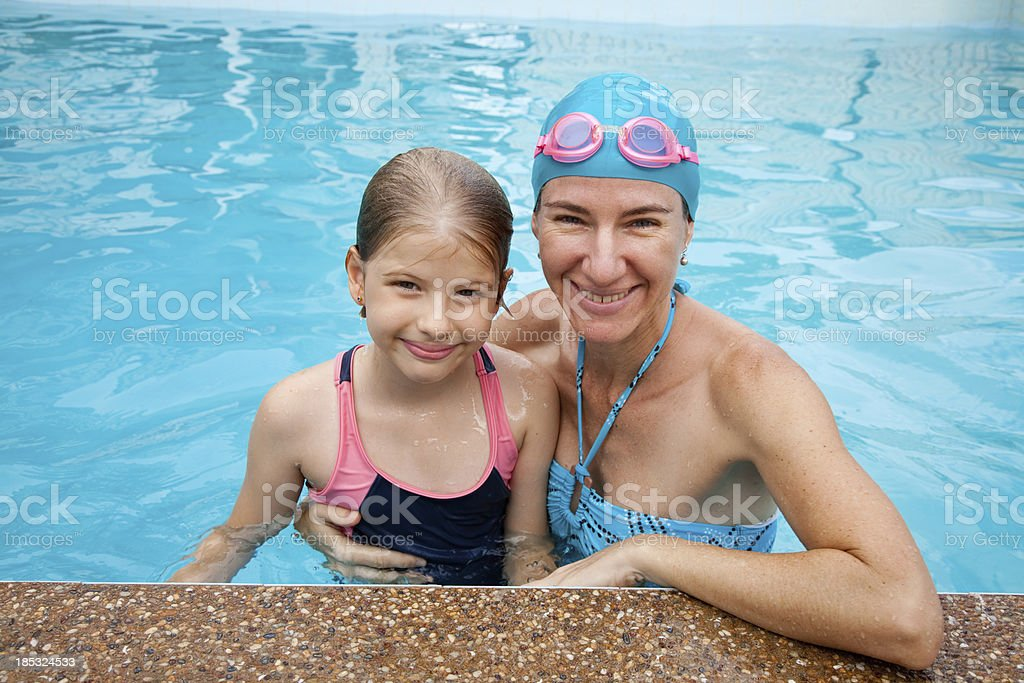 Mother & Child in Swimming Pool with goggles royalty-free stock photo