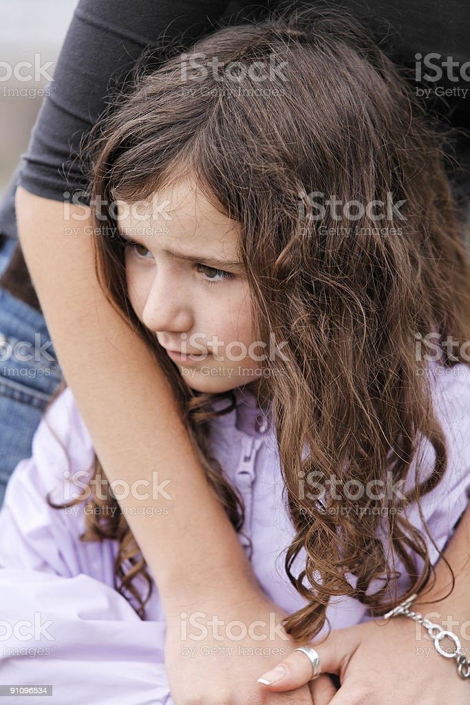Mother Clasps Cute, Dark-haired Daughter-More of same family below royalty-free stock photo