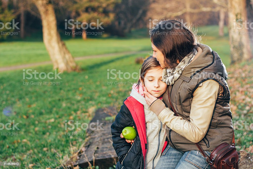 Mother Comforting Daughter stock photo