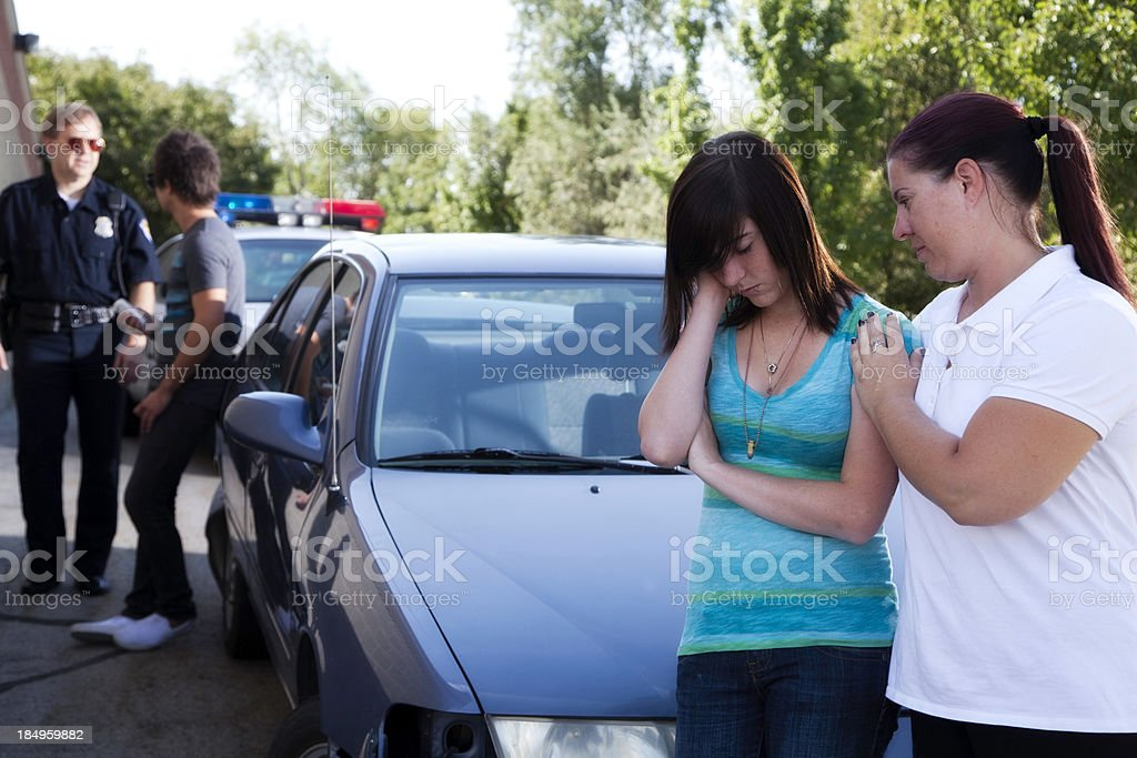 Mother Comforts Daughter After Accident or Police Stop stock photo