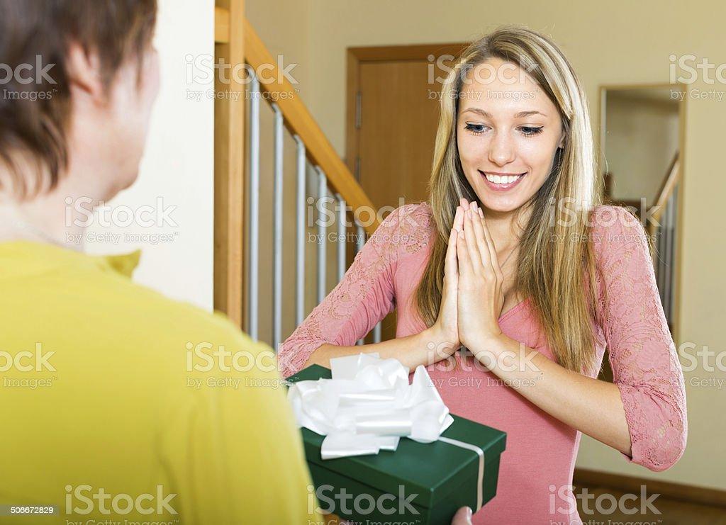 mother congratulating  daughter stock photo