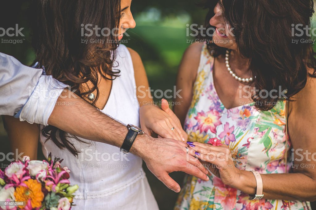 Mother Congratulating her Daughter on a Wedding day stock photo