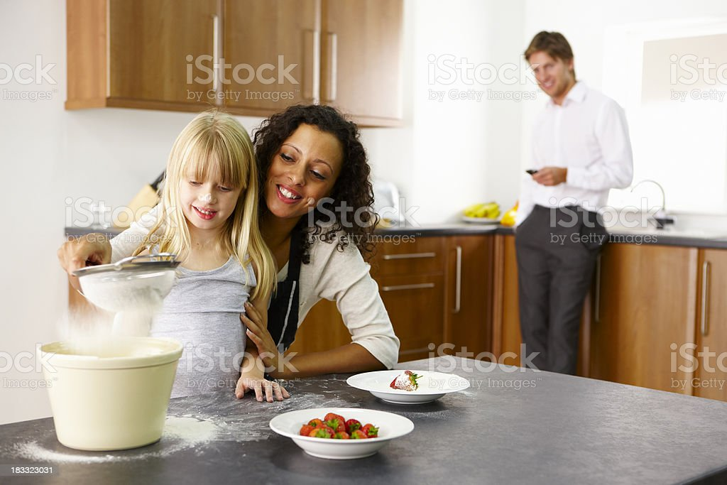Mother cooking with her daughter stock photo