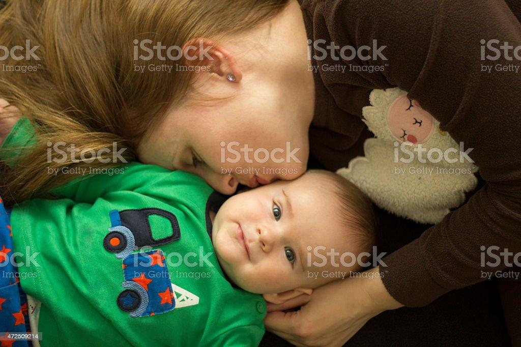 Mother cuddling baby boy stock photo