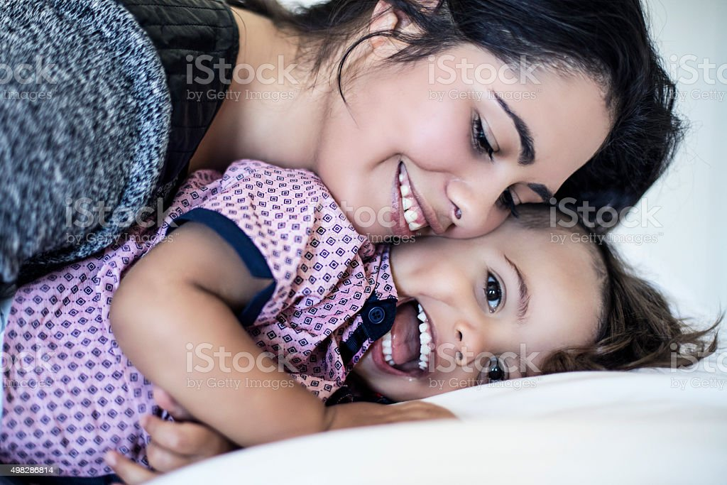 Mother cuddling her son stock photo