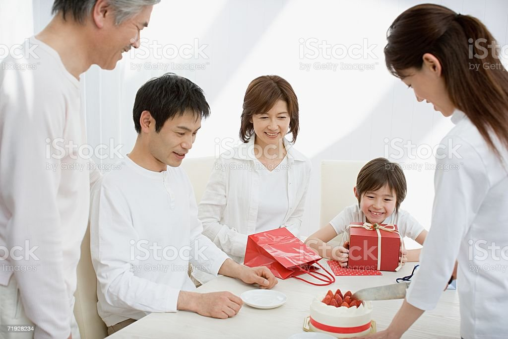 Mother cutting birthday cake for family royalty-free stock photo