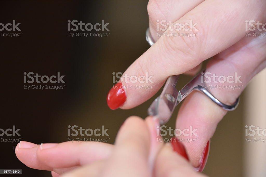 Mother cutting child fingernails stock photo