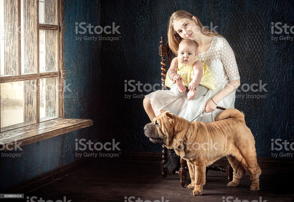 Mother, Daughter And Dog stock photo