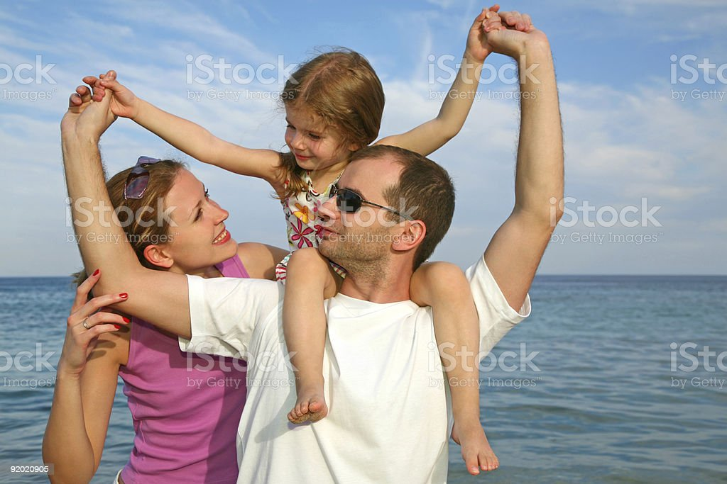 Mother, daughter and father on the sea royalty-free stock photo