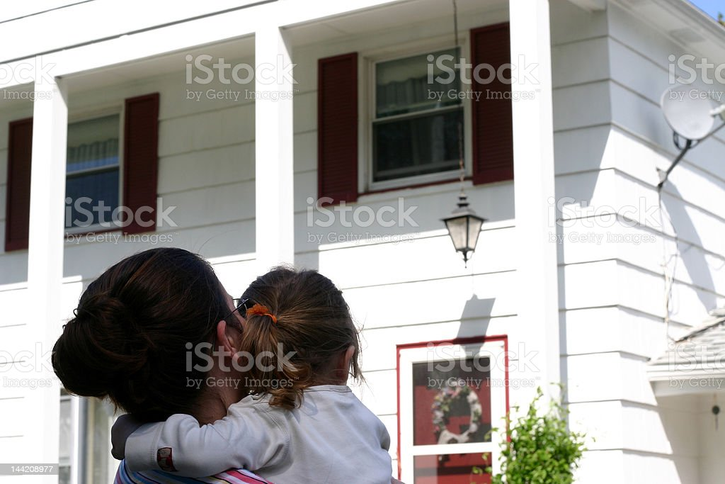 Mother, daughter, and home royalty-free stock photo